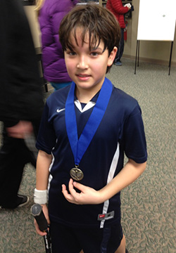Ian after winning his first tennis tournament in 2013